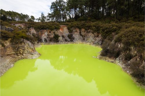 A bright green geothermal pool