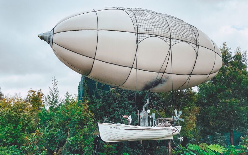 Unique places to visit on New Zealand's North Island include these seeing a hot air blimp from the Hamilton Gardens