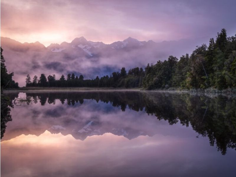 Lake Matheson at sunrise is one of our favourite Secret West Coast locations